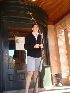 Cazey with his Gandalf staff at the doors of the Church of Scientology